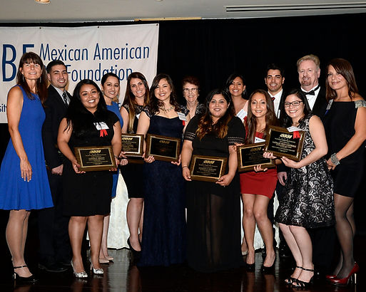 Image of scholars with plaques at fundraising gala