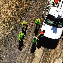 Crew planning in circle next to truck, image taken from above