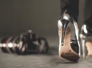 Silver stilettos walking towards professional camera