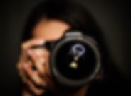 Hosanna holding camera to her face