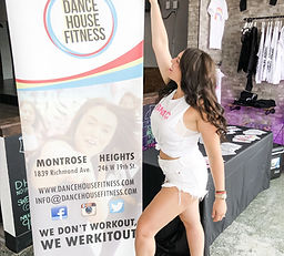 theFITista standing next to Dance Houst Fitness banner