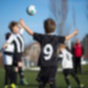 Children playng soccer