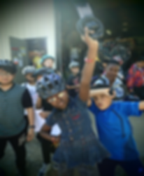 Children wearing bicycle safety helmets