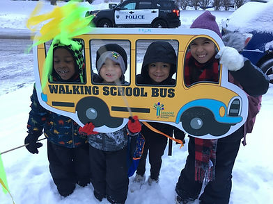 Leopold Walking School Bus route leader and students with cut out bus