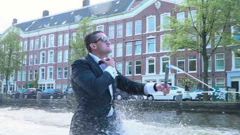 Casey Neistat arrives at TNW Conference... on a wakeboard.