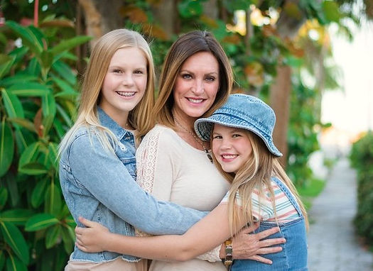 Founder and CEO Karen Rae, with daughters