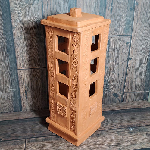 terracotta garden lantern with three square holes on all sides