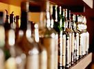 A picture of alcohol bottles on a back bar shelf