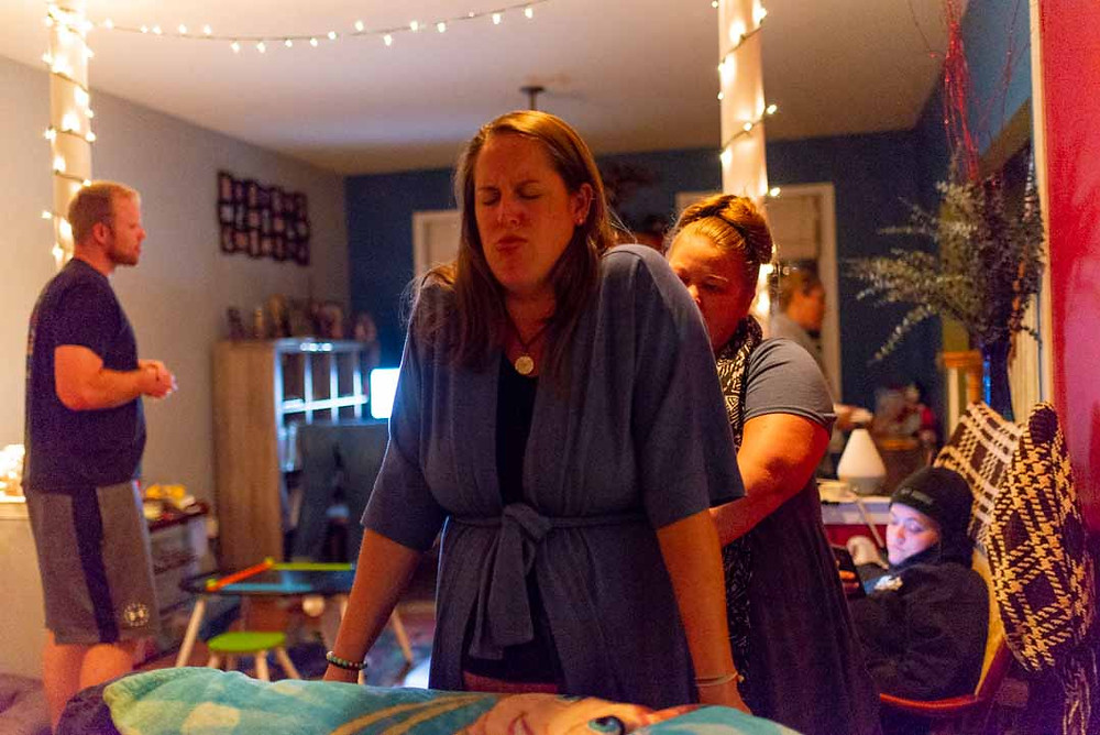doula supporting a mom during home birth
