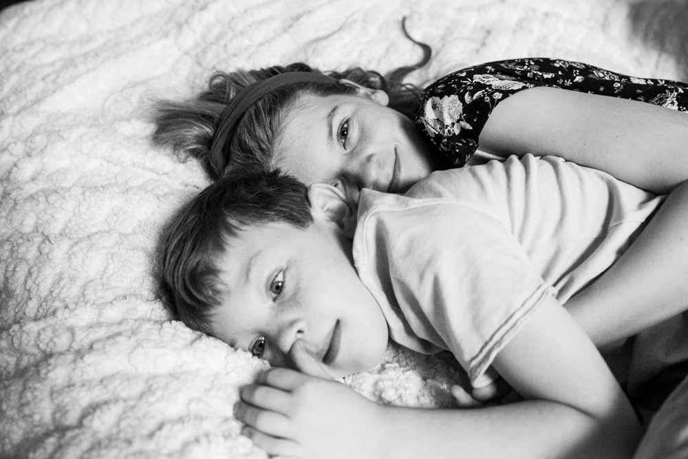 sister cuddling her little brother