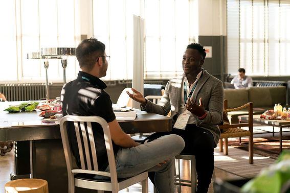 Two men talking.jfif