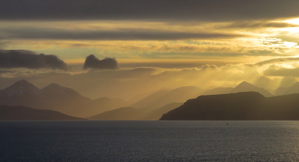 In mid January we took a leisurely drive out around the Applecross Peninsula and spent some time watching a submarine out on exercise towards the Isle of Raasay. Just as we were about to drive on the sun broke through the clouds creating this beautiful light over Raasay, and the Cullin's on the Isle of Skye in the distance - January 2020