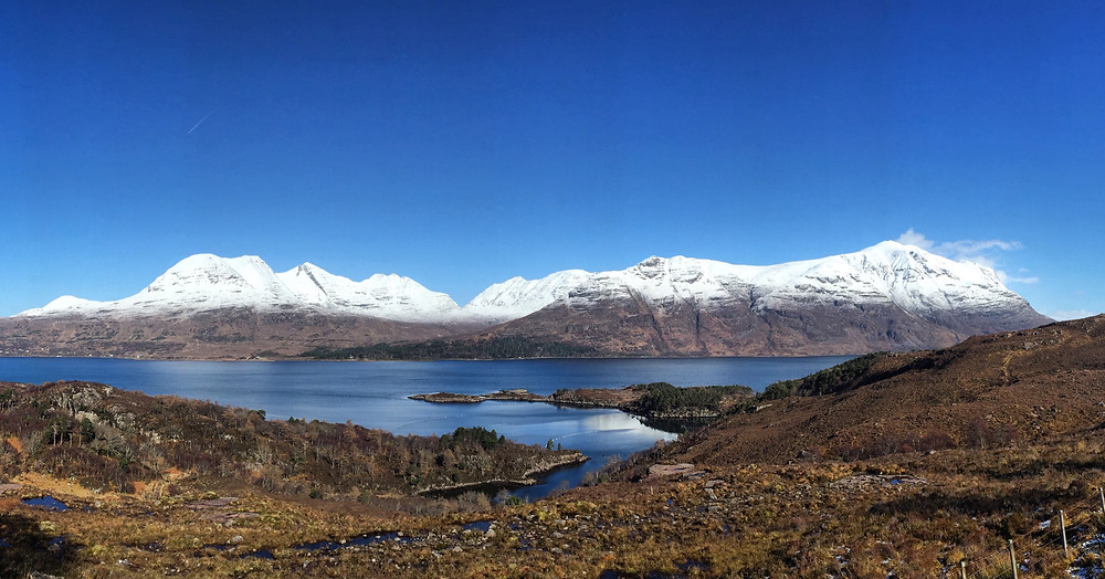 From left to right: Beinn Alligin (Jewelled mountain), Beinn Dearg (Red mountain) and Liathach (The grey one), from across Upper Loch Torridon - March 2020.