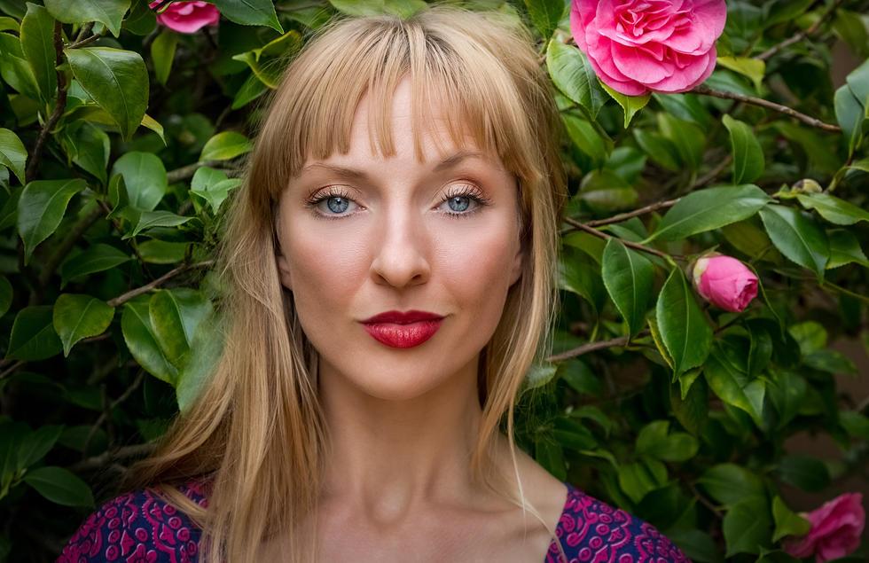 Photo of Beautful blonde female model in garden