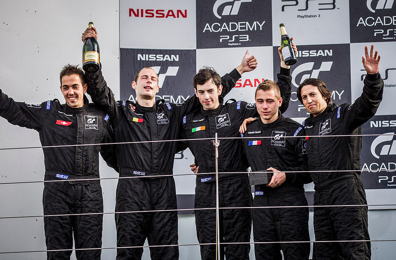 Des Foley celebrates on the podium at Silverstone