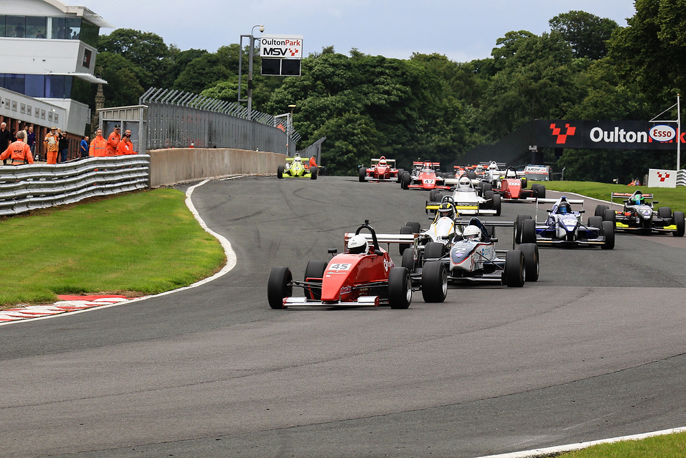 Mark Reade leads the field at the start of Race 1