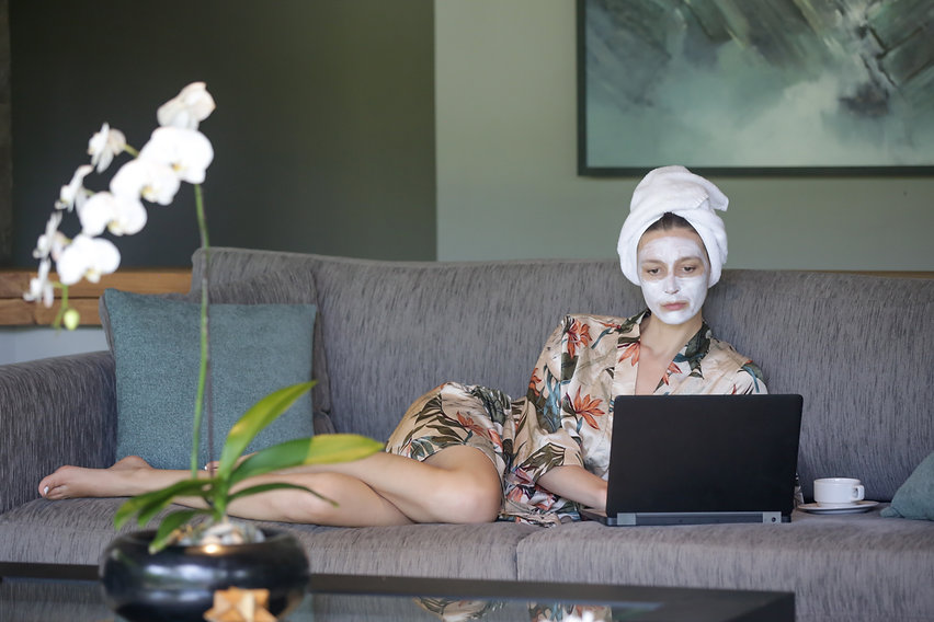 Young woman sitting at home with face be