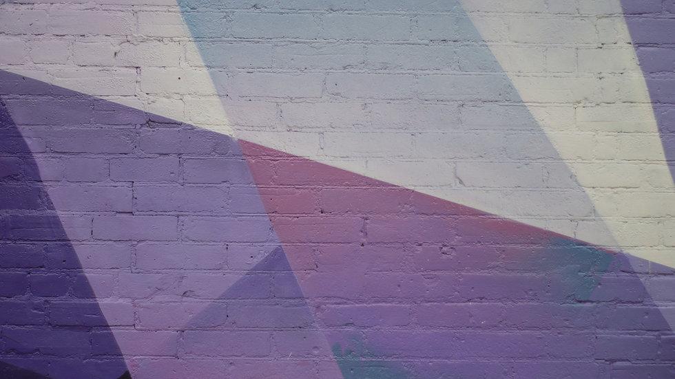 geometric-purple-urban-art-on-brick-wall