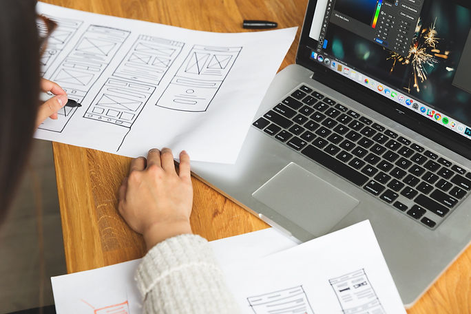 female-designer-reviewing-wireframes.jpg