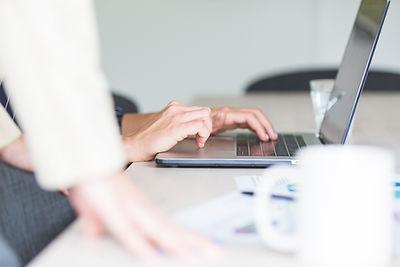 hands-using-computer-in-office.jpg