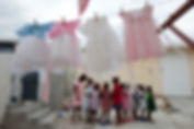Children from the House of Hope orphanage stand outside their home while doing laundry.