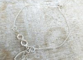 Ashes to Silver Memorial Heart Charm on an infinity slider bracelet