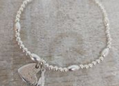 Ashes to Silver Memorial Heart Charm on beaded bracelet with feather charm