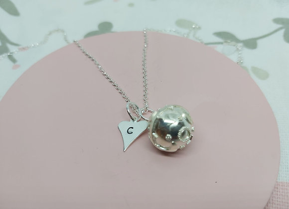hand stamped heart with melody ball necklace in Sterling Silver