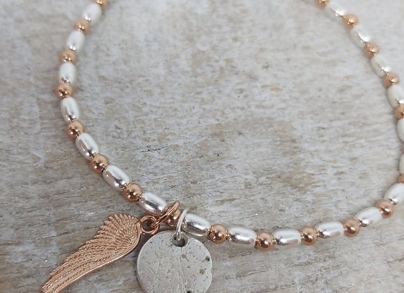 Ashes Memorial circle charm on beaded bracelet & rose gold wing