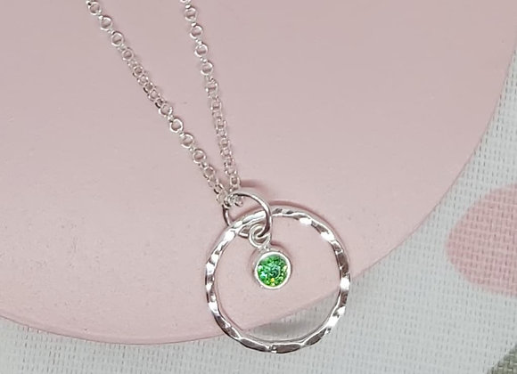 Hammered hand textured circle with birthstone necklace in Sterling Silver