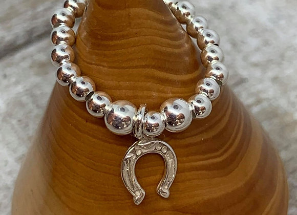 Sterling silver beaded ring with horseshoe charm