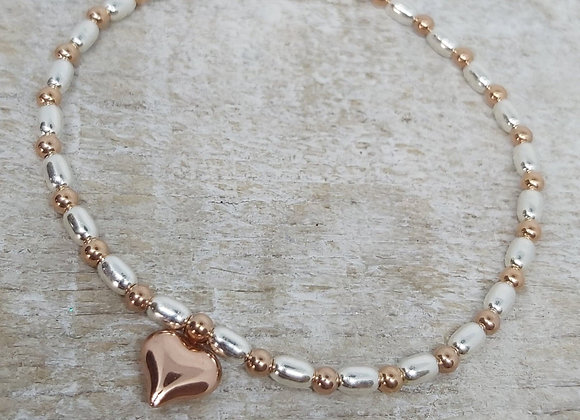 Benny&Moo rose gold seed and bead bracelet with gold puffed heart charm