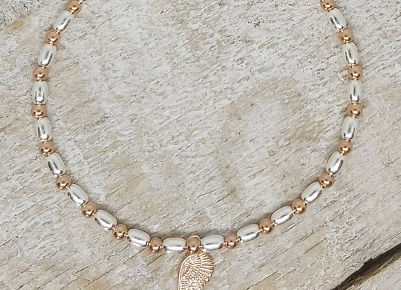 Benny&Moo rose gold seed and bead bracelet with gold wing charm