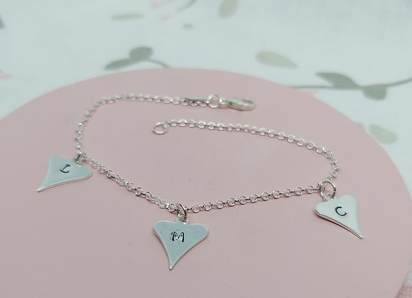 Hand stamped quirky hearts charm bracelet in Sterling Silver
