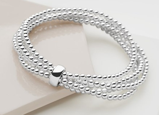 Multi strand  sterling silver beaded bracelet with silver ring charm