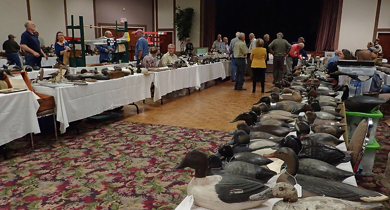 2017 Show & Sale Canadian Decoy and Outdoor Collectibles Association. Decoys on tables.