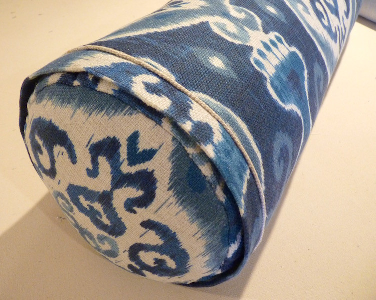 A bolster pillow with a fabric flange