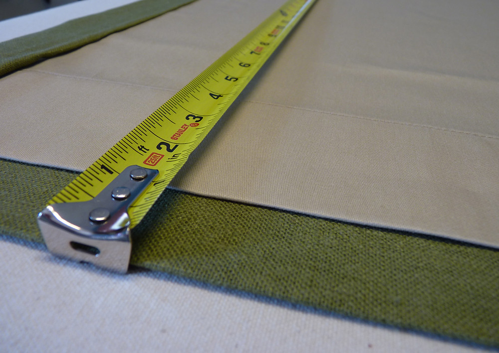Measuring the length on a lined and interlined drapery.