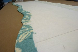 Glue the fabric to the back of the interfacing.