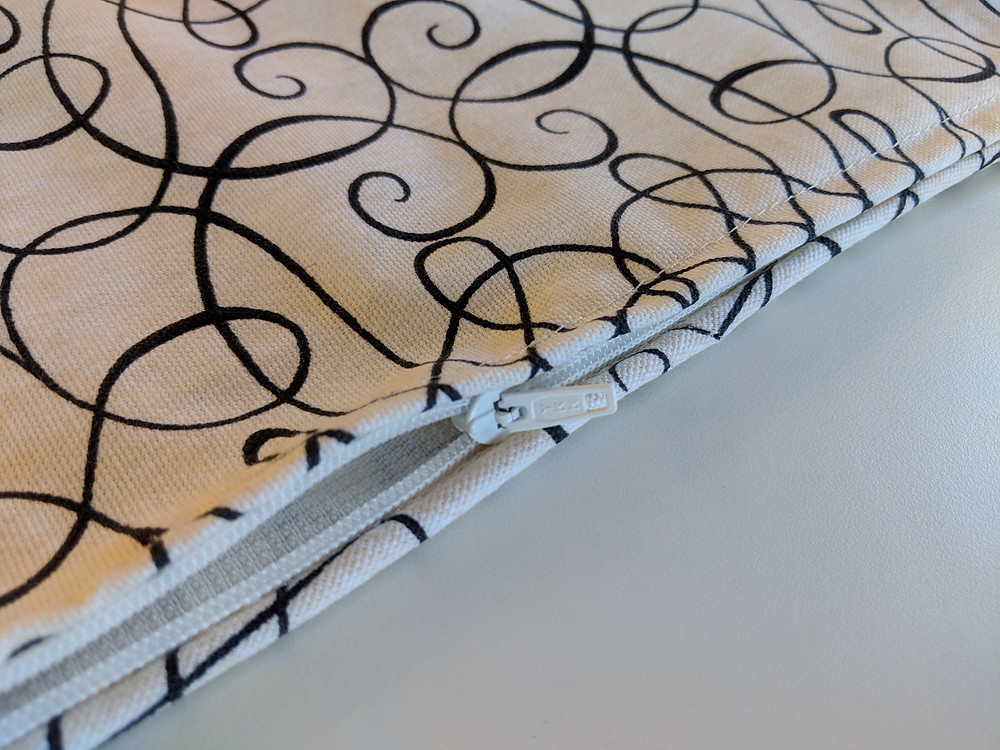 A knife edge pillow with welt cord and a nylon coil zipper.