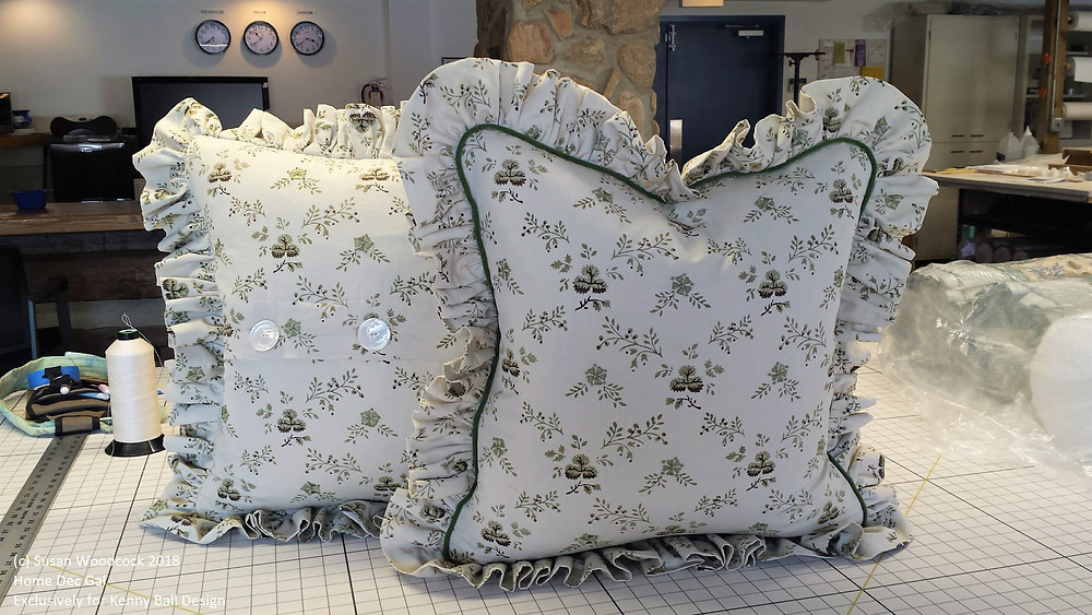 Pillows with gathered ruffles and button closure.