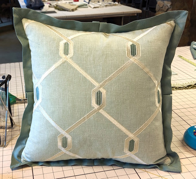 A center pleat is added to the flange.  This pillow was made in class at Workroom Tech by Rebecca with Plucky Pillows.