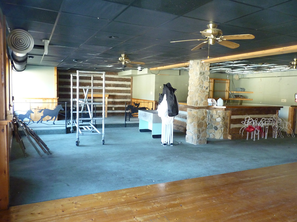 A former restaurant and bar.  We will keep the bar and use it as a conference area for viewing presentations and as a place to gather and socialize.