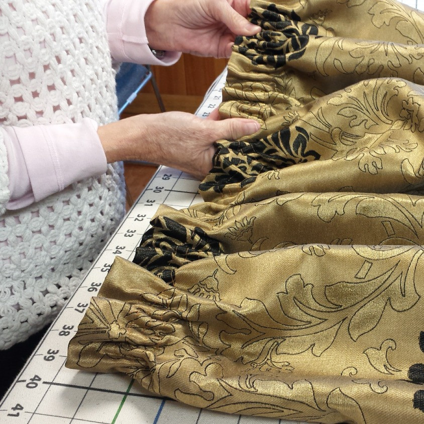 This drapery heading made with a sew-on tape.  The cords are pulled to create small pleats.