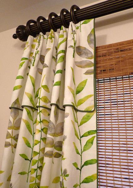 Drapery with attached valance on decorative hardware