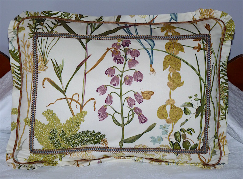pillow sham with a small flange that is gathered around the corners