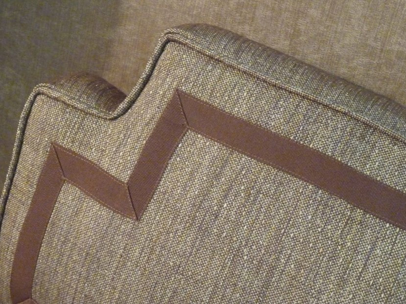 Boxed pillow with cut out corners and inset ribbon