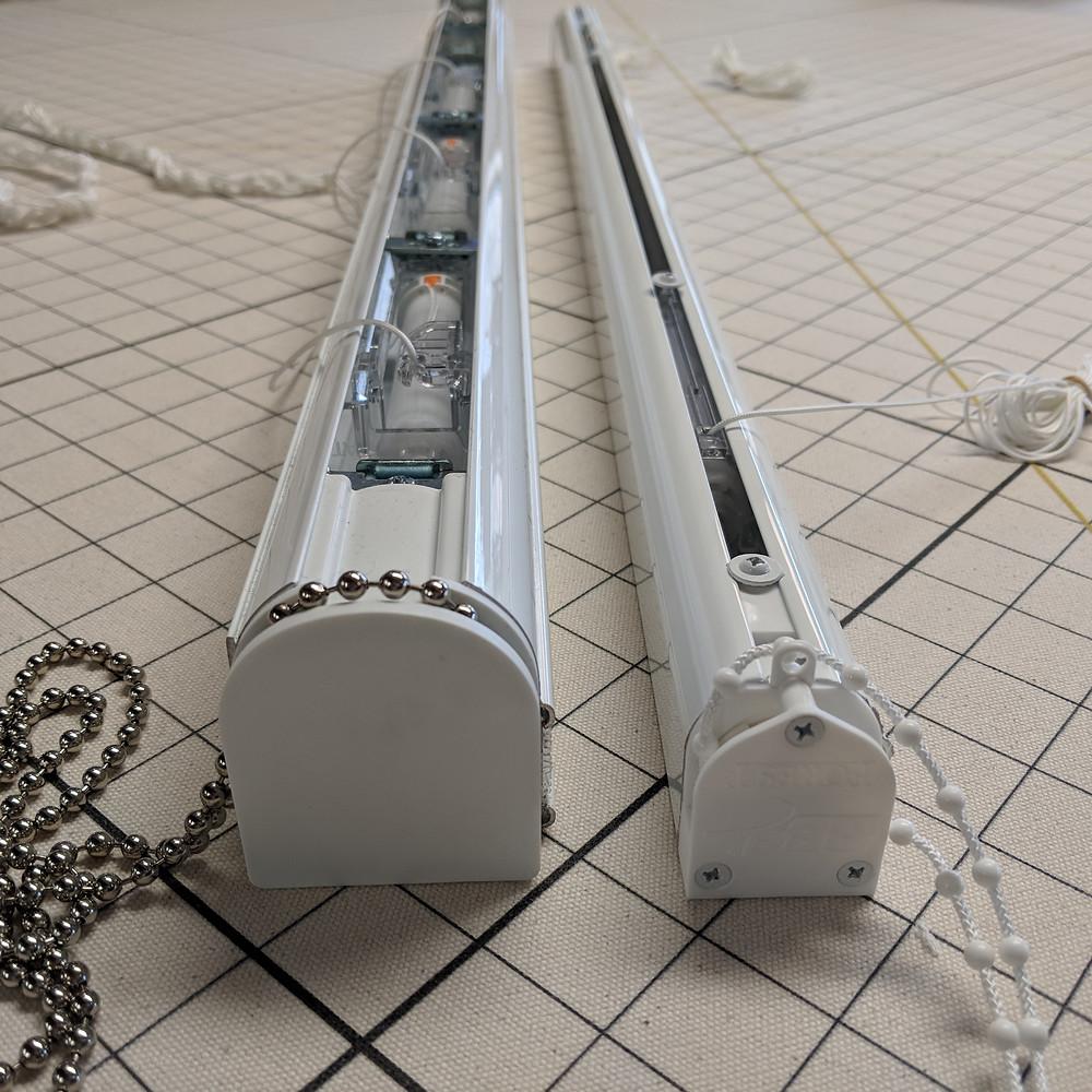 Roman shade headrail tracksystems