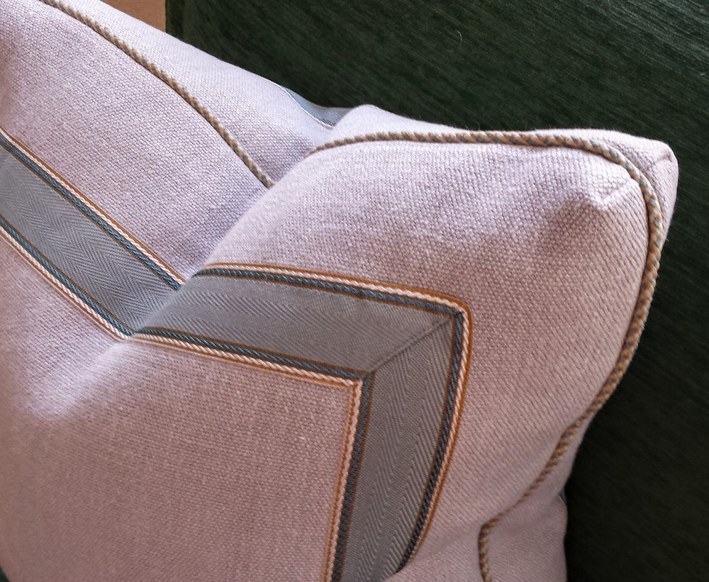 Linen pillow with inset tape.