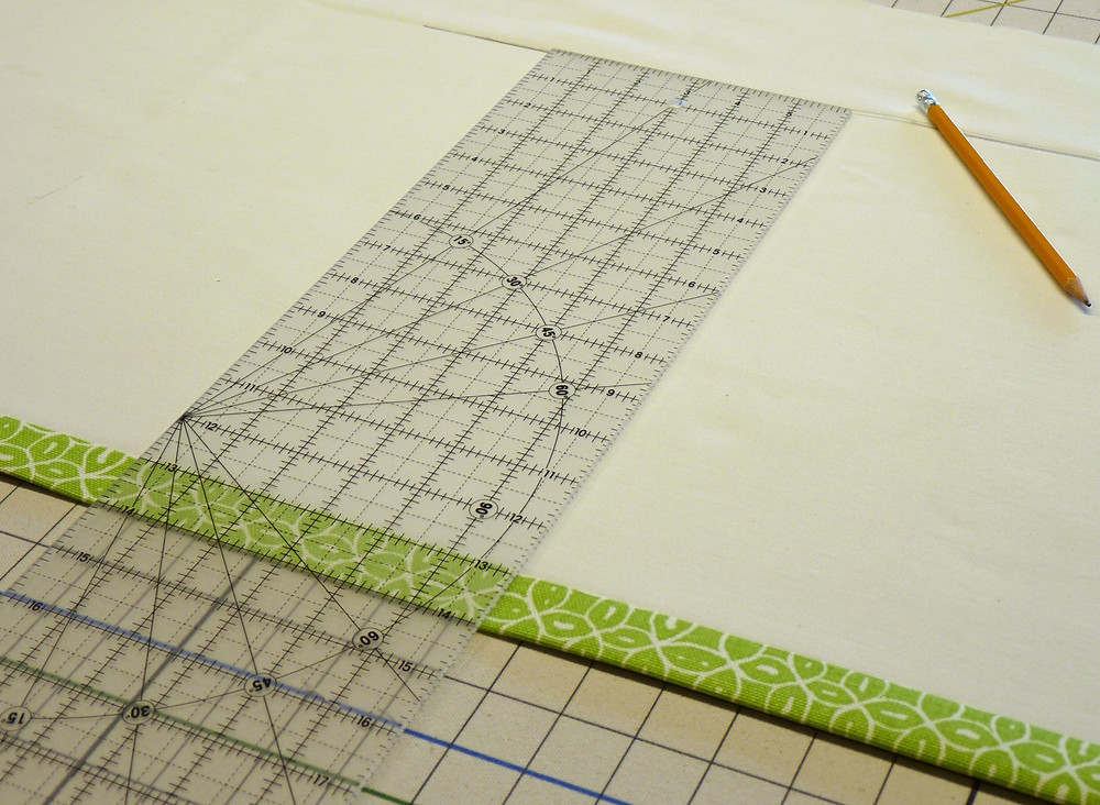 Clear quilters ruler are helpful in the workroom.